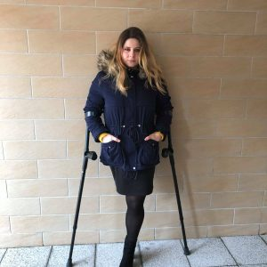 Amputee Eva: Outside crutching clip, black pantyhose, black crutches